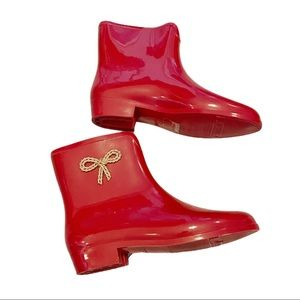 Mel by Melissa red ankle rain boots with bow